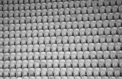 Stadium seats. Football Stadium seats grey background Stock Image
