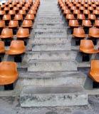 Stadium seats. Rows of orange seats in a stadium in Bangkok, Thailand Stock Photography