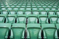 Stadium seats. Green color perspective Stock Image
