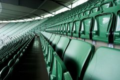 Stadium seats. Green color perspective Stock Photo