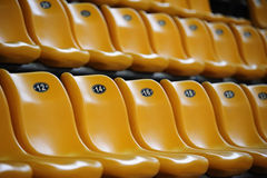 The stadium seats. Rows of empty yellow seats at stadium Stock Image