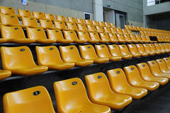 The stadium seats. Rows of empty yellow seats at stadium Stock Photo