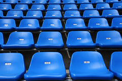 The stadium seats. Rows of empty blue seats at stadium Royalty Free Stock Images