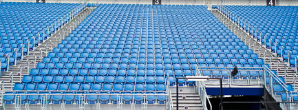 Stadium Seats. Blu Empty Seats In Rows In An Outdoor Stadium. Central tribune Stock Image