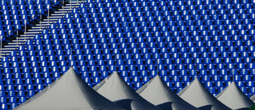 Stadium seats. An empty stadium awaits the roaring crowds. Will it be for soccer or football? Maybe baseball Stock Photos