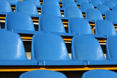 Stadium seats. Empty section of blue seats on stadium stock photography