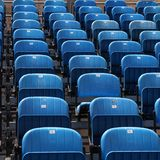 Stadium seats. Blue rows of chairs at an outdoor concert. Audience seats. Square composition Stock Photos