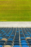 Stadium seats and grass Stock Images