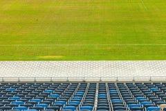 Stadium seats and grass Royalty Free Stock Image