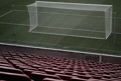 Stadium Seats Near White Soccer Goal Royalty Free Stock Photography