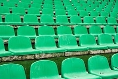 Stadium seats. Old green auditorium seats on small stadium Royalty Free Stock Photo