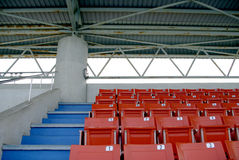 Stadium seats at outdoor swimming pool Stock Photos