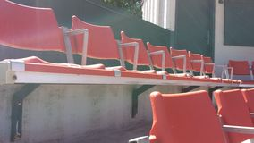 Stadium Seats 4. Red empty stadium seats shady seats sunny chairs Royalty Free Stock Images