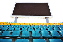 Stadium seats and score board. Stadium seats with large score board display screen Stock Photo