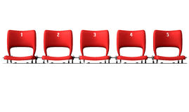 Stadium Seats Section. A section of numbered stadium seating with red chairs set in a row on an isolated white studio background Stock Photo