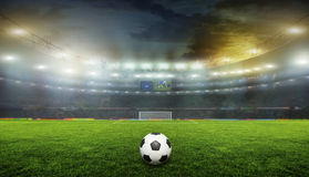Stadium. Soccer ball on the field of stadium with light Royalty Free Stock Photo