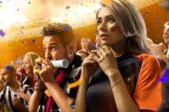 Stadium soccer fans emotions portrait. In yellow toning royalty free stock photography