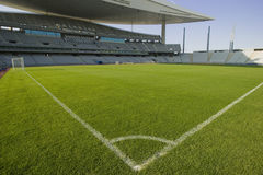 Stadium and Soccer Lines. Green grass field and corner lines in an empty stadium Stock Images