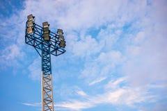 Stadium spotlight in cloudy sky Stock Photo