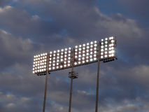 Stadium-style lights against a cloudy sky Royalty Free Stock Images