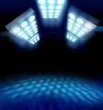 Stadium style premiere lights. Illuminating blue surface on dark background stock illustration
