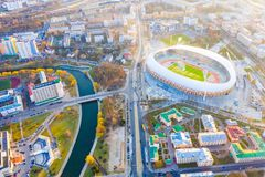 Stadium surrounded by buildings aerial view. Dinamo arena in Minsk stock images