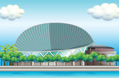 A stadium surrounded with trees Stock Photos