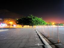 Stadium Three. Illuminated tree and fence at night in stadium parking lot royalty free stock photography
