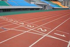 Stadium track. Straight lanes of running track in stadium royalty free stock photography
