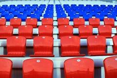 Stadium tribune, empty chairs. The stadium tribune, people left there were empty chairs Royalty Free Stock Photos