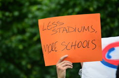 Less Stadiums, More Schools Handwritten Sign of Protest Royalty Free Stock Photos