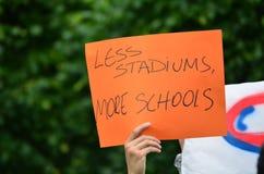 Less Stadiums, More Schools Handwritten Sign of Protest. Handwritten Sign of Protest saying `Less Stadiums, More Schools Royalty Free Stock Photos