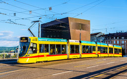 Stadler Tango tram in the city centre of Basel. Royalty Free Stock Images