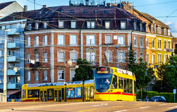 Stadler Tango tram in the city centre of Basel. Royalty Free Stock Photos