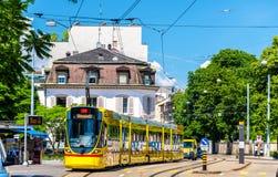 Stadler Tango tram in the city centre of Basel. Stock Photo