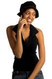 stads- kvinna för celltelefon arkivbild