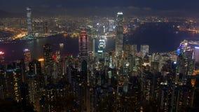 Stads- panorama för Hong Kong horisont på nattetidschackningsperioden Kina Zoom ut arkivfilmer