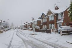 Stads- stadsväg med snow och is Arkivbild