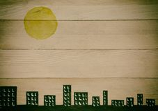 Stadshorizon op natuurlijke houten panelen Stock Afbeelding