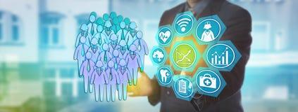 Stadsplanerare som aktiverar vård- ledning för befolkning Arkivfoto