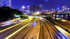 Stadsrusningstid. Hong Kong Traffic Timelapse. Åtsittande skott. arkivfilmer