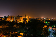 Stadsscape på nattetid Arkivfoto