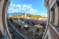 Stadssolnedgång på fönsterfisheye Fotografering för Bildbyråer