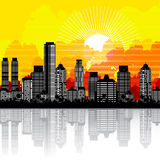stadssoluppgång Arkivbild