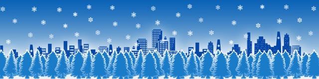 Stadt in einer schneebedeckten Nacht Lizenzfreie Stockbilder