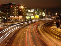 Stadt-Leuchten an der Nachtzeit Stockfotos
