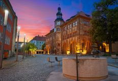 Stadt Nordhausen Rathaus with Roland figure in Germany. Stadt Nordhausen Rathaus sunset city hall with Roland figure in Thuringia Germany Royalty Free Stock Photo