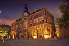 Stadt Nordhausen Rathaus with Roland figure in Germany. Stadt Nordhausen Rathaus sunset city hall with Roland figure in Thuringia Germany Royalty Free Stock Images