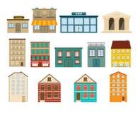 Stadt und Vorstadtgebäudeikonen auf weißem Hintergrund Lizenzfreies Stockfoto