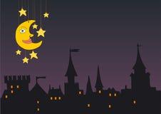 Stadt unter dem Mond Stockfotos
